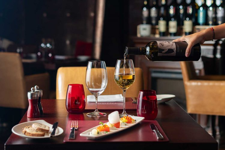 Prime-Steakhouse---pouring-white-wine